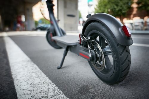 Black electric scooter with kickstand